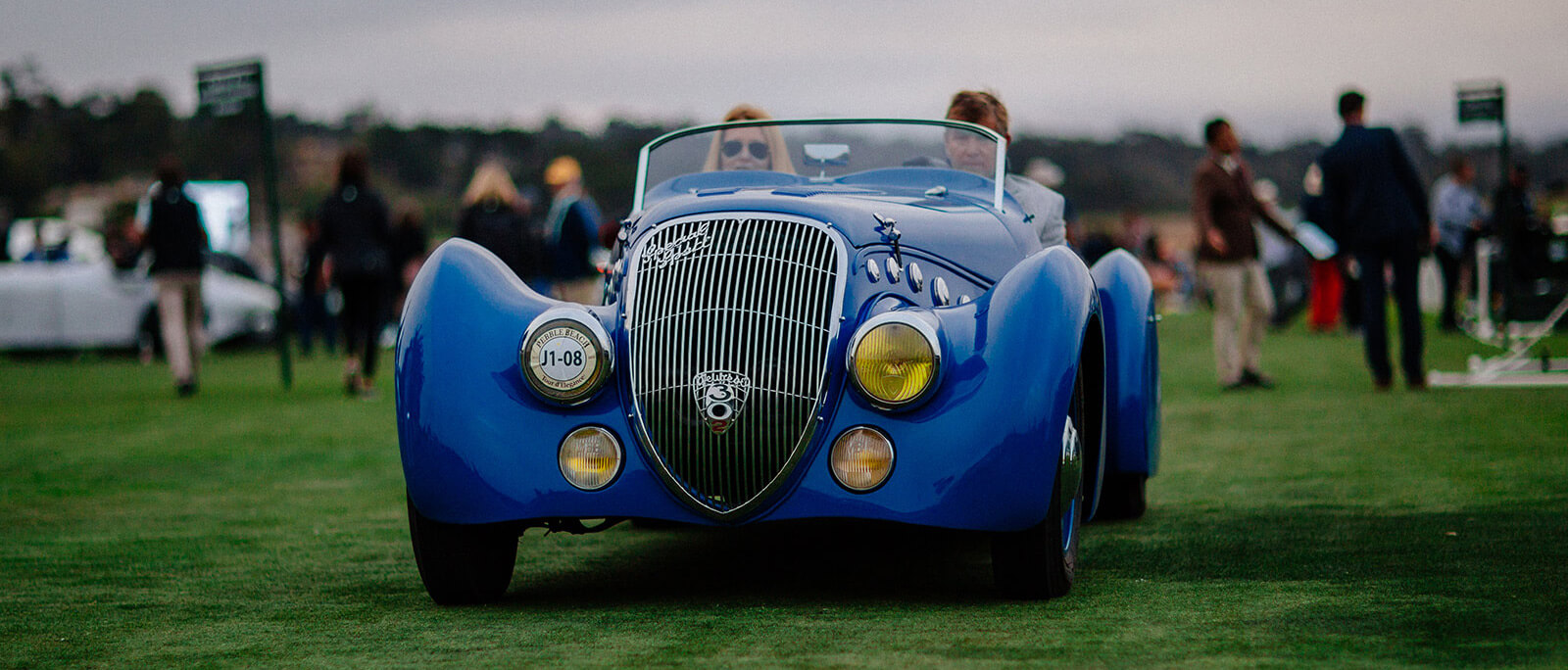 Blue car driving on the Show Field at the Pebble Beach Concours d'Elegance 2019