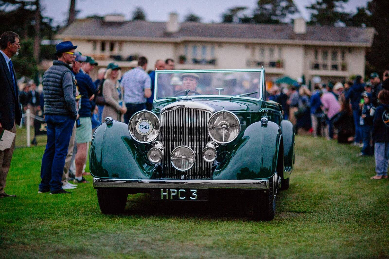 A Pebble Beach Concours entrant driving onto the show field at Dawn Patrol presented by Hagerty