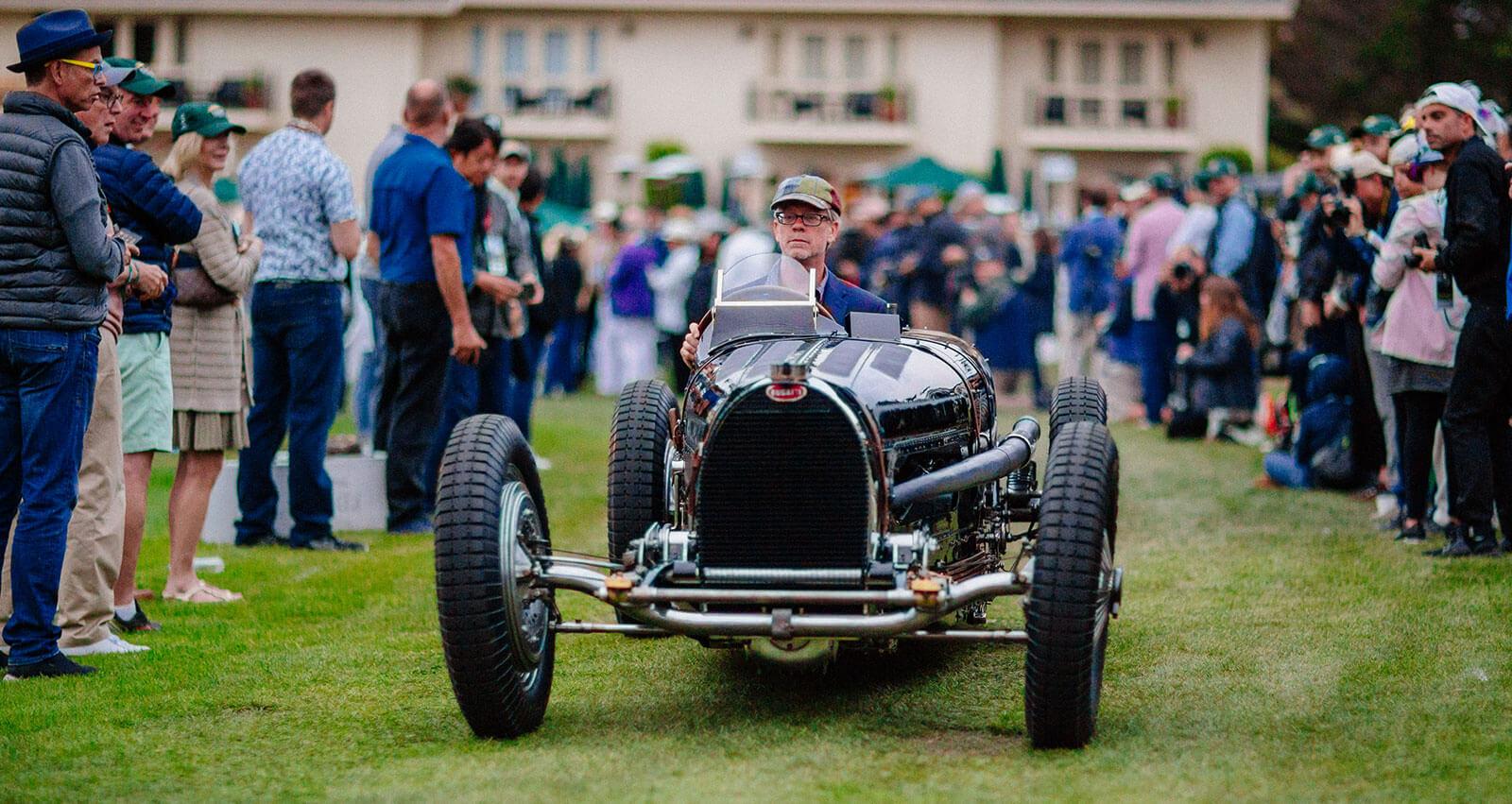 Bugatti driving onto the show field at Dawn Patrol