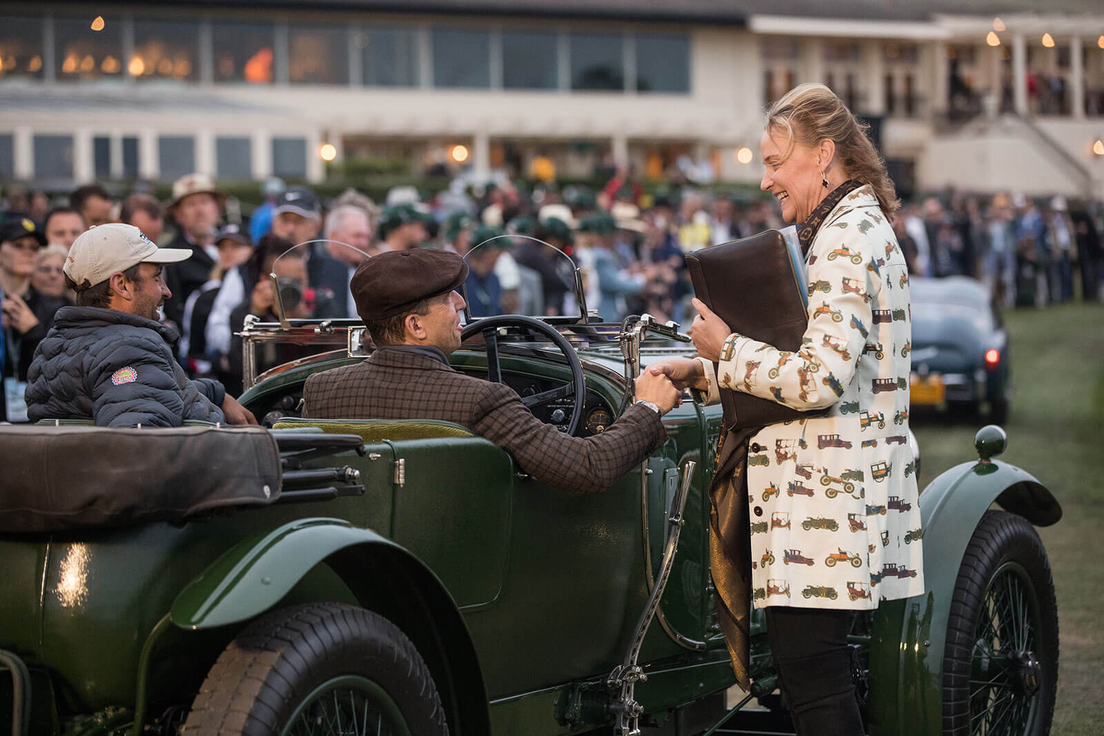 Chairman Sandra Button greeting entrants at Dawn Patrol presented by Hagerty