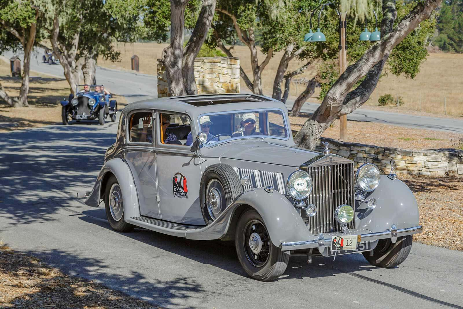 The Pebble Beach Tour d'Elegance driving through Tehama in Carmel, CA.