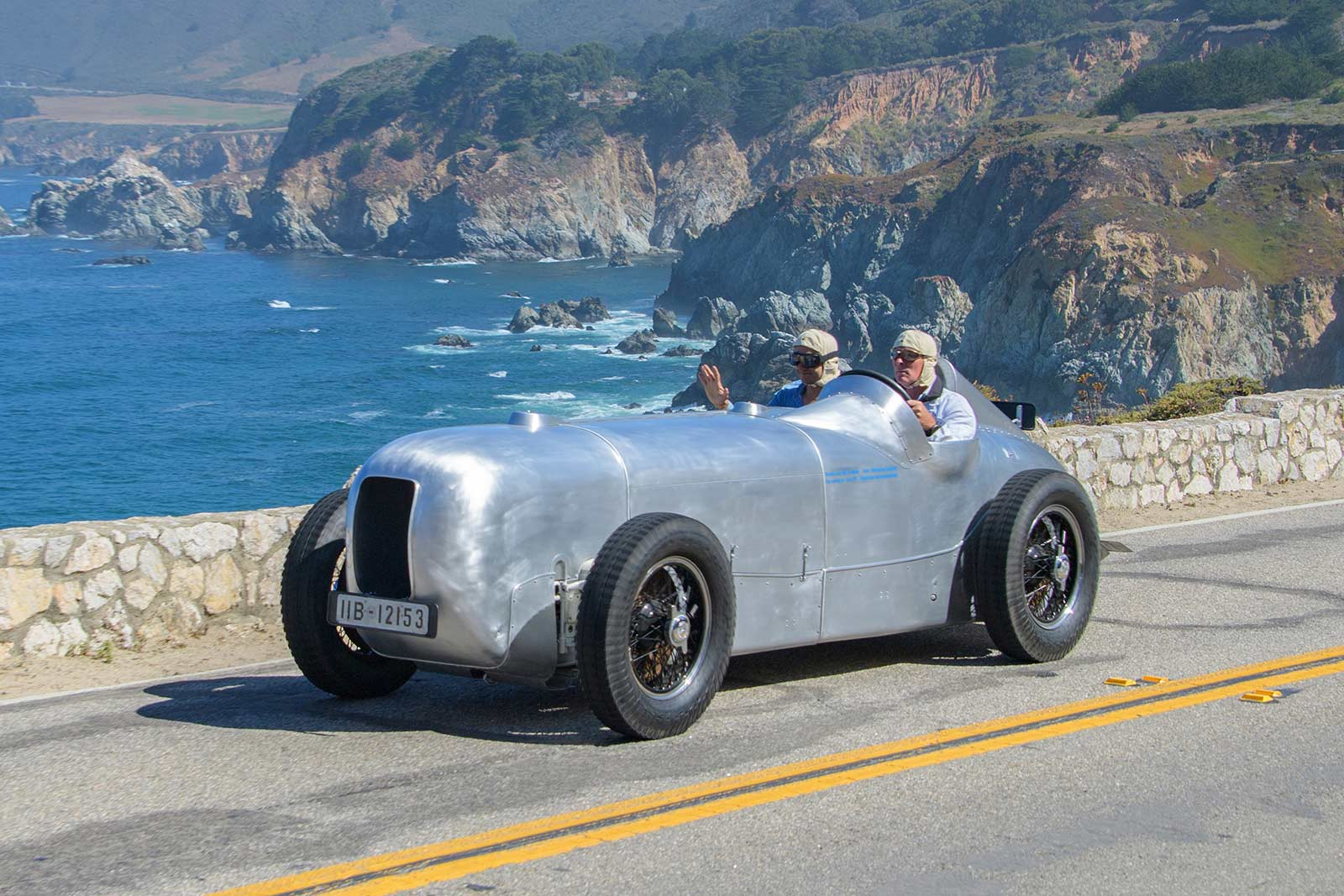 The Pebble Beach Tour d'Elegance driving down Highway 1 in Big Sur, CA.