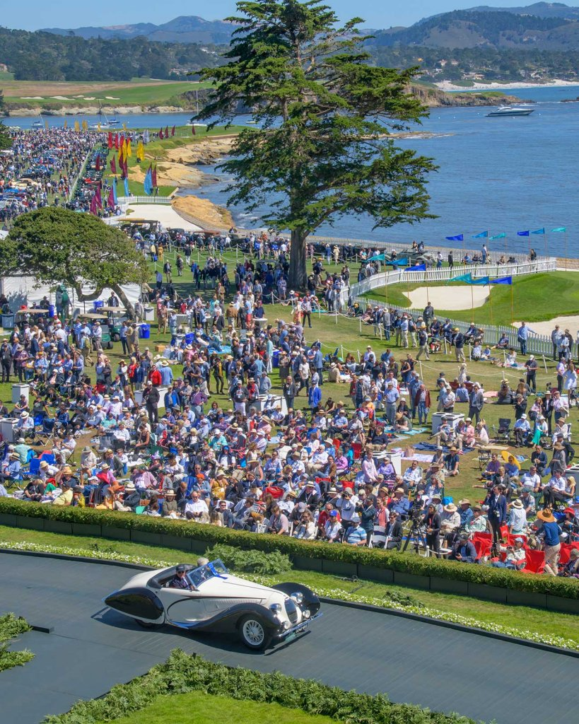 Pebble Beach Concours d'Elegance Class Winner driving over ramp